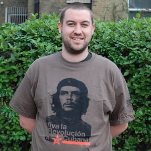 T-Shirt: Che Guevara Viva la revolucion cubana - Cuba50 - black and orange on olive